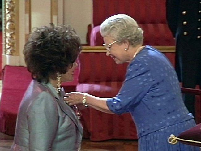 Elizabeth and Elizabeth - A videograb shows Elizabeth Taylor receiving the honor of Dame Commander of the Order of the British Empire from Britain's Queen Elizabeth II at a ceremony at Buckingham Palace in 2000.