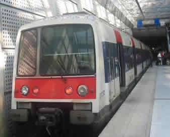 RER Paris Train At Charles De Gaulle (CDG) Airport. You ccan get to the paris down town by RER Train. train station is located between terminal 2 and terminal 2. get more infor http://www.parisairporttransfers.transfer-private.com