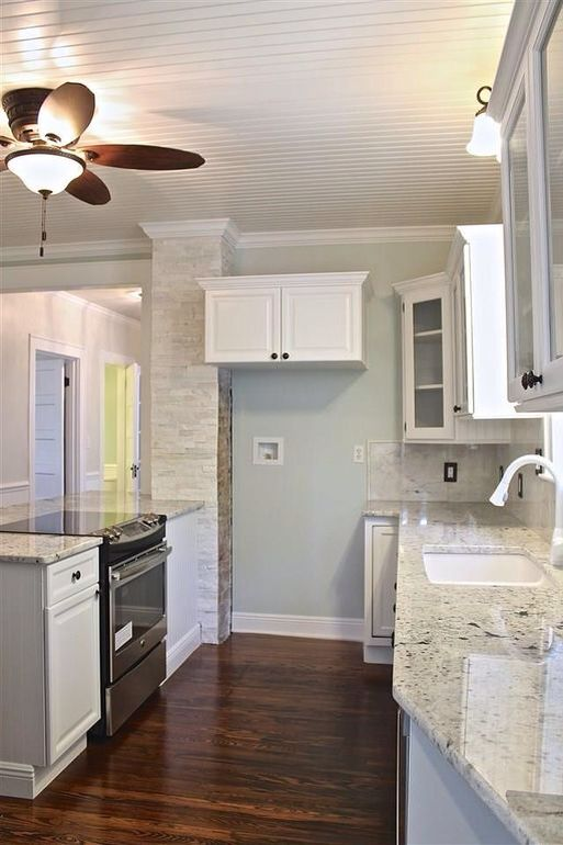 Alaskan white granite and sherwin Williams sea salt
