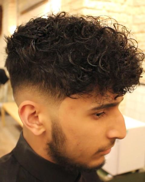 Low Skin Fade Curly Haircut With Disconnected Undercut , VIDEO