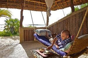 Ocean facing veranda with hammock at Kipungani Explorer, lamu