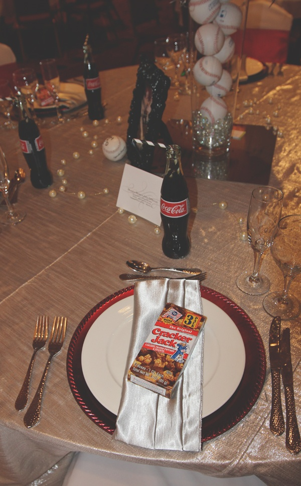 Cracker Jack favors and Coke bottles with striped straws at the Marilyn Monroe & Joe DiMaggio vintage baseball reception table. Linens by Mimi & Co.