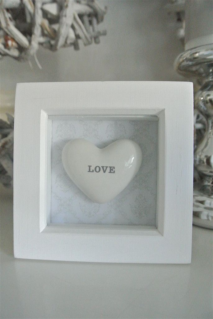 """""""Love"""" in a BoxWhite box frame with ceramic """"Love"""" heart comes mounted on a grey vintage background Measuring 120mm x 120mm Perfect gift for someone you love in your life Can be free standing or wall mounted Comes with personalised tag up to 15 words of you're choosing Just add the wording you require in """"Notes"""" when going through the check out process  Perfect for Wedding/Anniversary or Engagement and many more occasions  Part of our soft grey collection"""
