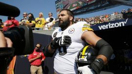 "The 6'9"" former Army Ranger stood outside with a hand over his heart for the ""Star-Spangled Banner"" for the game against the Chicago Bears."