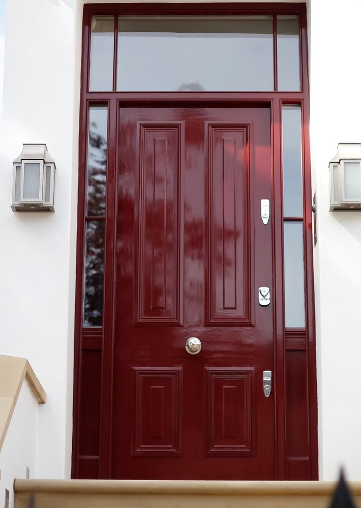 Our fabulous red timber door completed with chrome furniture