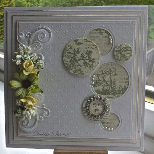 I like the way the circles are layered, some are negative die cuts. Without the flowers and less background layers this would make a nice card for men.