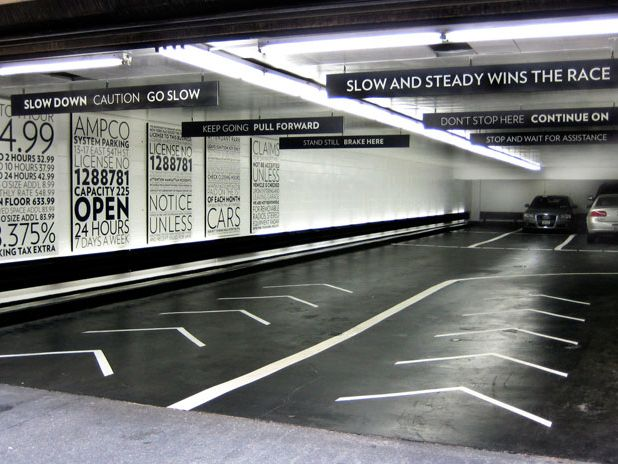 Paula Scher's 'toned down' signage for a seven-story garage located at 13-17 East 54th Street, between Fifth and Madison Avenues.