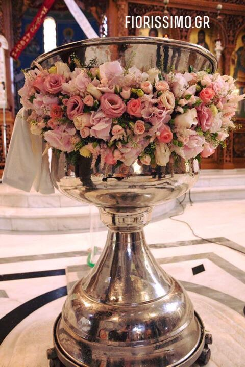 Greek Orthodox christening with white and pink flowers