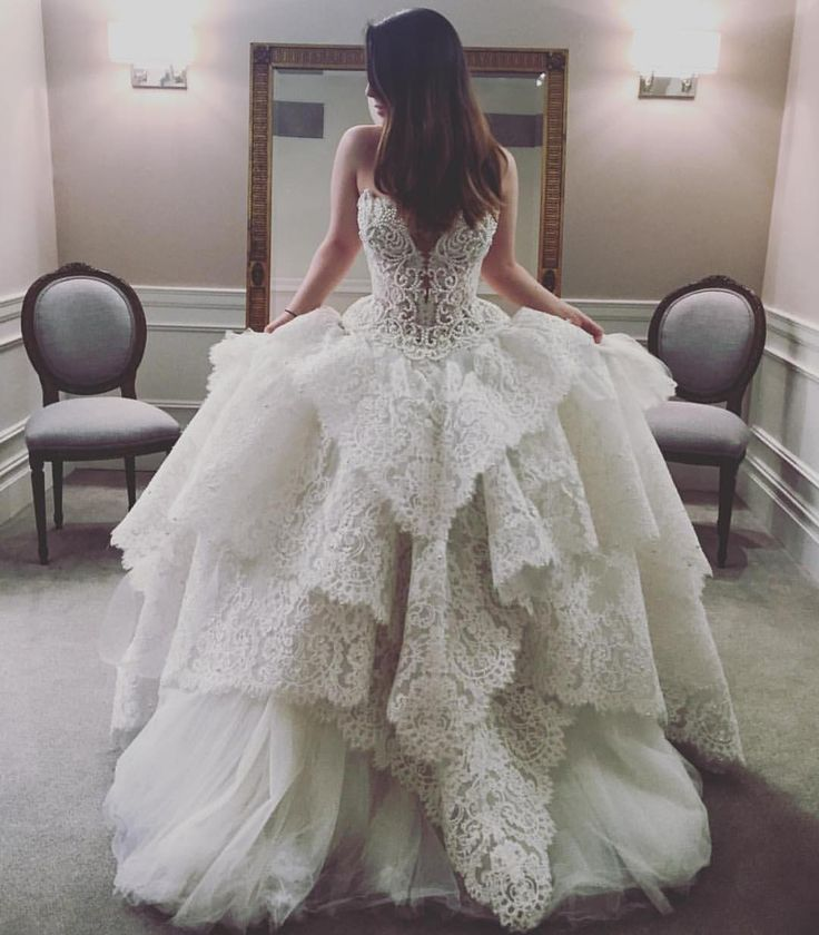 "Pnina Tornai on Instagram: ""Our @kleinfeldbridal headpiece consultant @zuzurae having fun trying on this jaw-dropping #WindUponWater pearl & lace embellished #ballgown. #workhardplayhard #bridalfashionweek"""