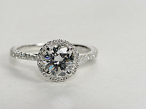An elegant creation, this diamond engagement ring in 14k white gold showcases a thin line of micropavé-set diamonds that encircle your center diamond. Setting includes 1/4 carat total diamond weight. #bluenile