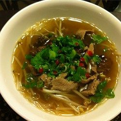 Beef Pho (Authentic South Vietnamese Style Pho). A comforting richly seasoned beef broth is ladled over rice noodles and thinly sliced beef, top with cilantro, basil, lime juice and bean sprouts