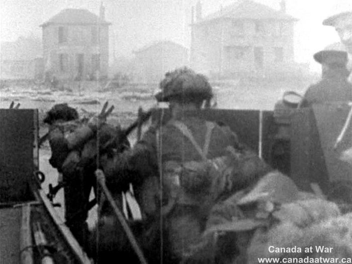 D-Day, Juno Beach - Soldiers of the 3rd Canadian infantry division hit the beaches of Normandy and begin the deadliest run of their lives. This image (a single frame from the video footage) of the first wave was captured by a camera on board a landing craft.