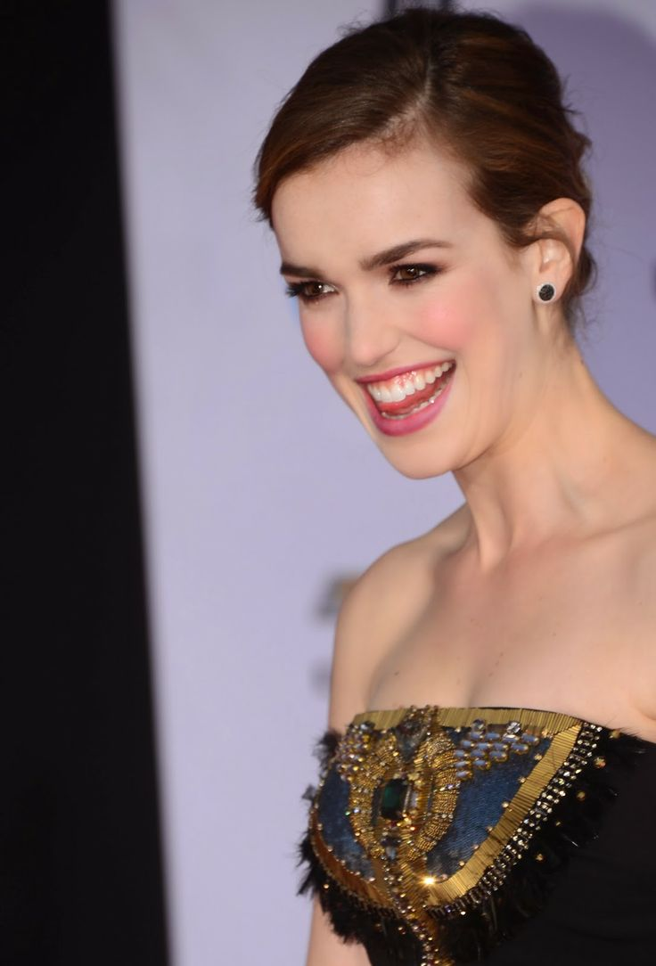"Actress Elizabeth Henstridge poses on arrival for the film premiere of Marvel's ""Captain America: The Winter Soldier""."