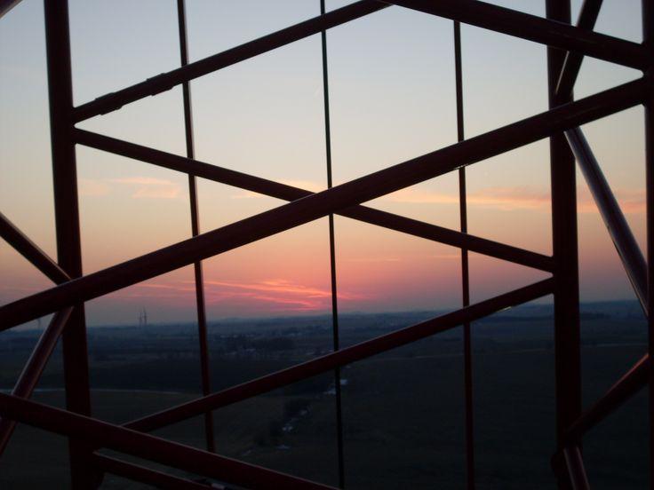 looking thru crane boom at sunset