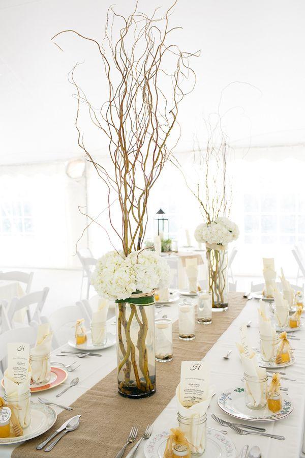 Tall centerpieces with an elegant rustic setting // photo by Kina Wicks http://ruffledblog.com/romantic-illinois-farm-wedding/