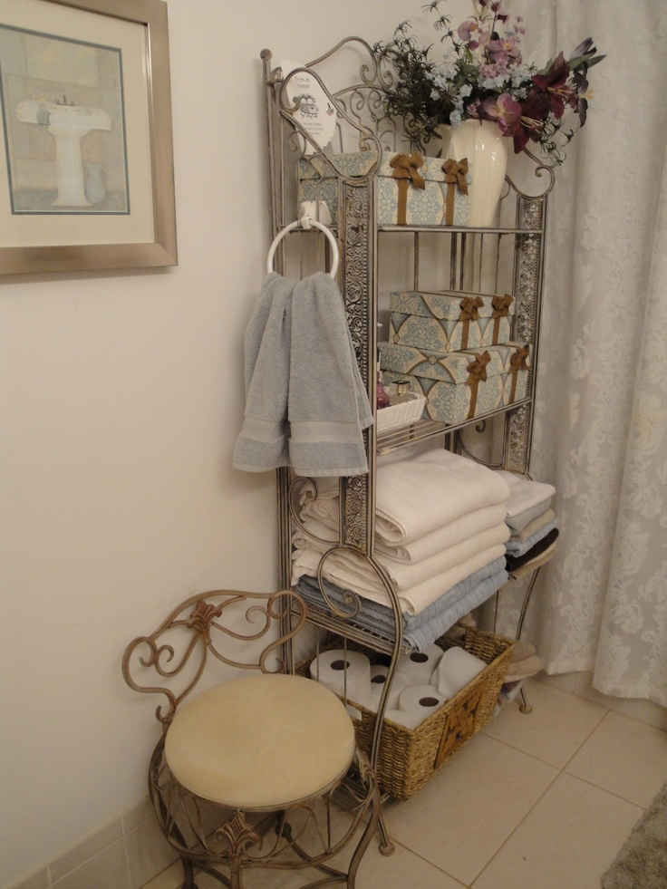 Using A Bakers Rack In The Bathroom Gives You Storage And Style. This Is An