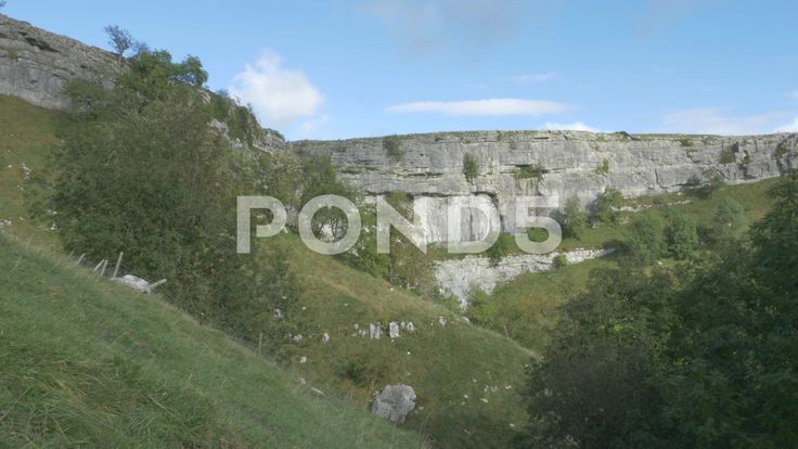 4K Peak of Malham Cove Cliff Lime Stone Rocks Countryside - Stock Footage | by RyanJonesFilms