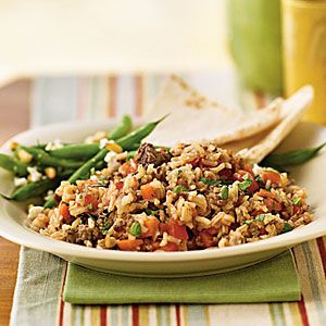 Greek Lamb Pilaf   MyRecipes.com. Made this this week. Good. Sweet flavor from the mint. Can easily change up spices to make hotter. We added bell peppers and edamame. Can serve leftovers for lunch on pita with hummus to make it a pizza. Kids LOVED it!