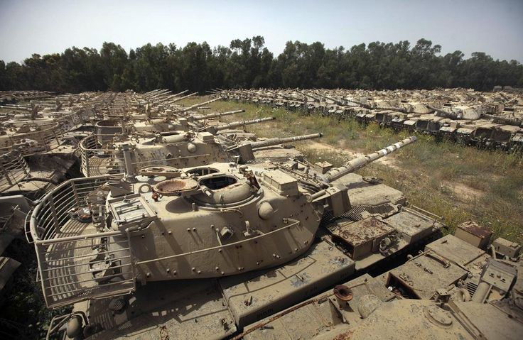 "Israeli Army decommissioned tanks are seen in a scrapyard in the ""tank cemetery,"" located inside an Army base near the southern Israeli city of Kiryat Gat, on May 5, 2011. Some 700 decommissioned Israeli tanks used by the Jewish state during different wars were for sale for about 0.25 USD/kilo, to be used for metal recycling."