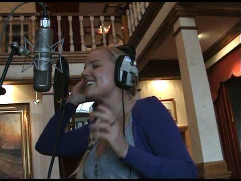 Kerry Ellis is a West End performer who's played Elphaba in Wicked. This is a rock rendition of her singing 'Defying Gravity' produced by Brian May from Queen.