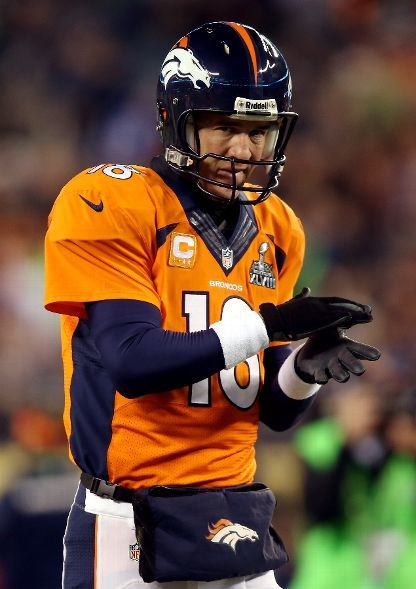 EAST RUTHERFORD, NJ - FEBRUARY 02: Quarterback Peyton Manning #18 of the Denver Broncos warms-up before playing against the Seattle Seahawks during Super Bowl XLVIII at MetLife Stadium on February 2, 2014 in East Rutherford, New Jersey. (Photo by Jeff Gross/Getty Images)