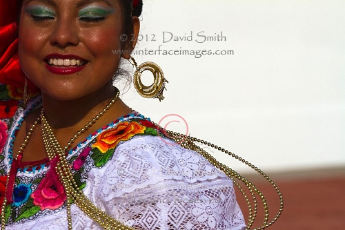 Close-up views and head and shoulder portraits of smiling traditional ethnic dancers in Puerto Chiapas, Chiapas, Mexico wearing colorful Latin American costumes