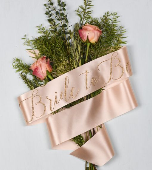 This beautiful handmade sash is straight from the Oh Squirrel studio in London. This classy peach beauty says Bride to be in gorgeous calligraphy. It comes in a pretty box and is a super special accessory and gift for the bride on her hen do.