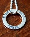 """Cheer Affirmation Necklace This necklace is a fantastic cheer gift for yourself, favorite cheerleader or Cheer Coach.  Cheer jewelry makes a great keepsake gift for cheer competitions, cheer camps, birthdays and holidays.  This sterling silver necklace features one Open Circle Charm engraved with """"Cheer"""" on your choice of sterling silver chain."""