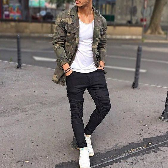 An olive camo denim jacket and black slim jeans will convey a carefree easy…