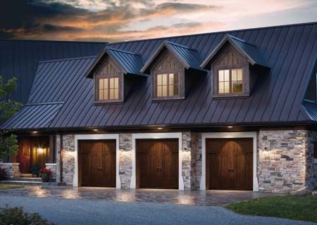 The appearance of the clopay canyon ridge faux wood garage for Log cabin style garages