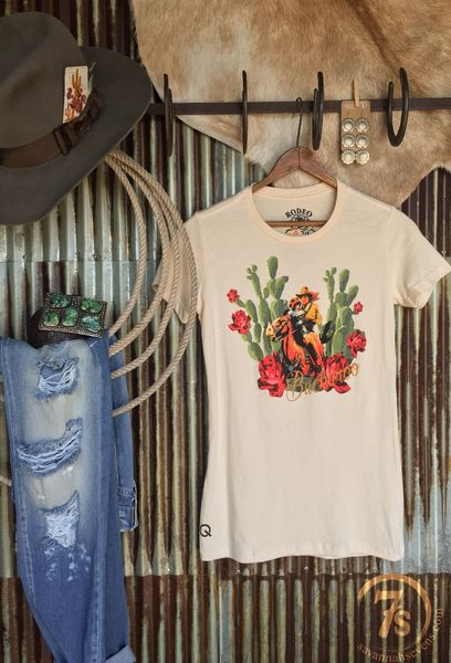 "The Buckaroo {ivory} - ""Buckaroo"" cactus graphic fitted tee. Colorful cowboy and damsel in distress, cacti, floral and horse graphic. Ivory fitted tee. Original graphic design by Rodeo Quincy. Soft slim fit."