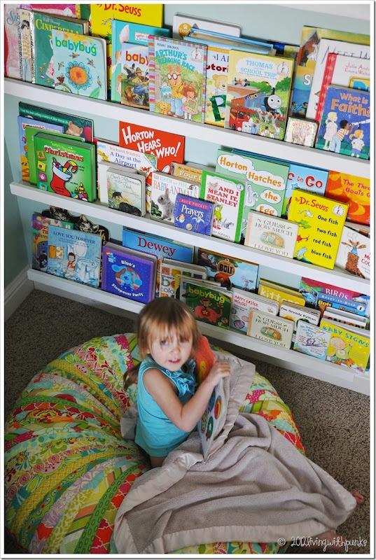 DIY Linear Bookshelves.  Smartest part of her room!