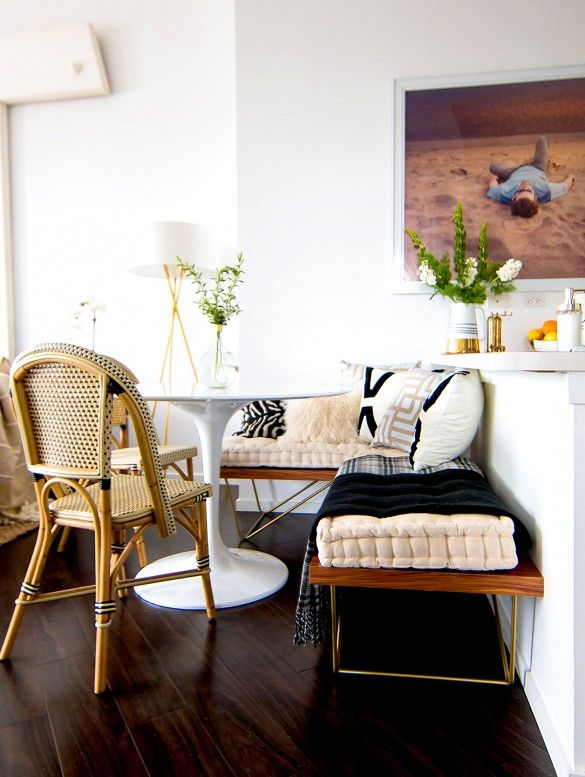 Nice combo of styles: midcentury bench, contemporary photograph, tulip table, and bistro chair.  Domaine Home tour: glam bohemian loft in Chicago.