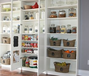 Billy bookcase as kitchen cupboards, for a blank wall or top cupboards. You'll see and find everything much easier. They come with glass door option, so you can choose fabric etc as feature and maybe leave peepholes.