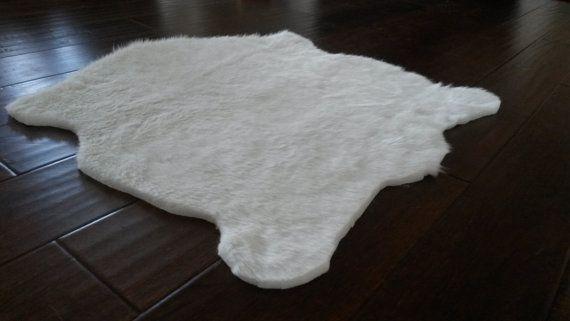 Beautiful Faux Fur Rug- lambskin shape  Dimensions:  2 x 2.5 2 x 3 3 x 4 3 x 5 5 x 7  Perfect decor highlight to accent any room!  Rug matting