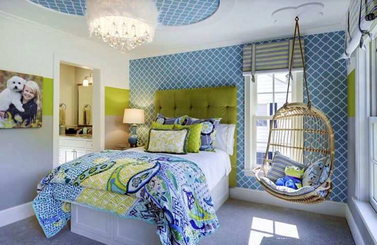 Luxury kids bedroom with rattan swinging chair bed with tufted headboard and glam feather chandelier
