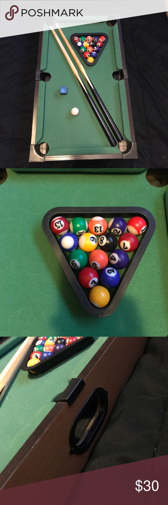 Full tabletop pool table Full tabletop pool table. Includes ( full set of pool balls, cue ball, two pool sticks, stick chalk) Other