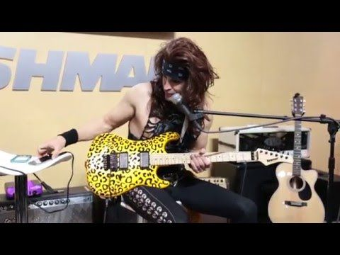 Russ Parrish AKA Satchel of Steel Panther at Fishman Pick Ups Booth