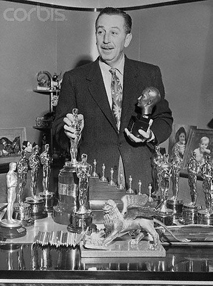 In honor of Oscar night, here's Walt Disney showing off only a few of his Oscar statuettes.    Walt Disney holds the record for highest number of individual Oscars received with a total of 29 Academy Awards.