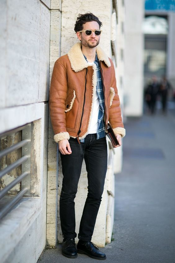 Try teaming a khaki shearling jacket with black jeans for a Sunday lunch with friends. Channel your inner Ryan Gosling and throw in a pair of black leather derby shoes to class up your look. Shop this look on Lookastic: https://lookastic.com/men/looks/shearling-jacket-long-sleeve-shirt-crew-neck-t-shirt/16062 — Blue Plaid Flannel Long Sleeve Shirt — White Crew-neck T-shirt — Tan Shearling Jacket — Black Jeans — Black Leather Derby Shoes