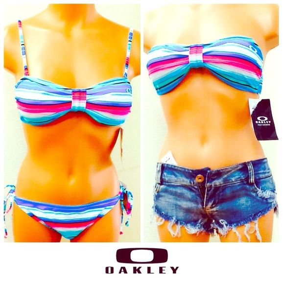 Oakley swimwear bikini bandeau blue white stripe👙 Oakley. New with tag. Wear these babies  as bikini or bandeau top with your sexy denim shorts!💋! Blue white pink stripes. Adorable! NO TRADE. Shorts (non brand) are sold separately for $25 size small. Check out my other OAKLEY collection, bundle and save👛! Oakley Swim Bikinis