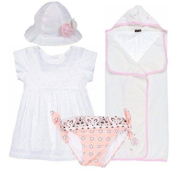 Costume a slip, con fantasia rosa e fiocchi ai lati, sotto al fresco vestito in cotone bianco, con lavorazione traforata, maniche corte e scollo tondo. Cappello in lino bianco, con applicazioni di fiori. Telo mare in spugna bianca, con dettagli rosa.