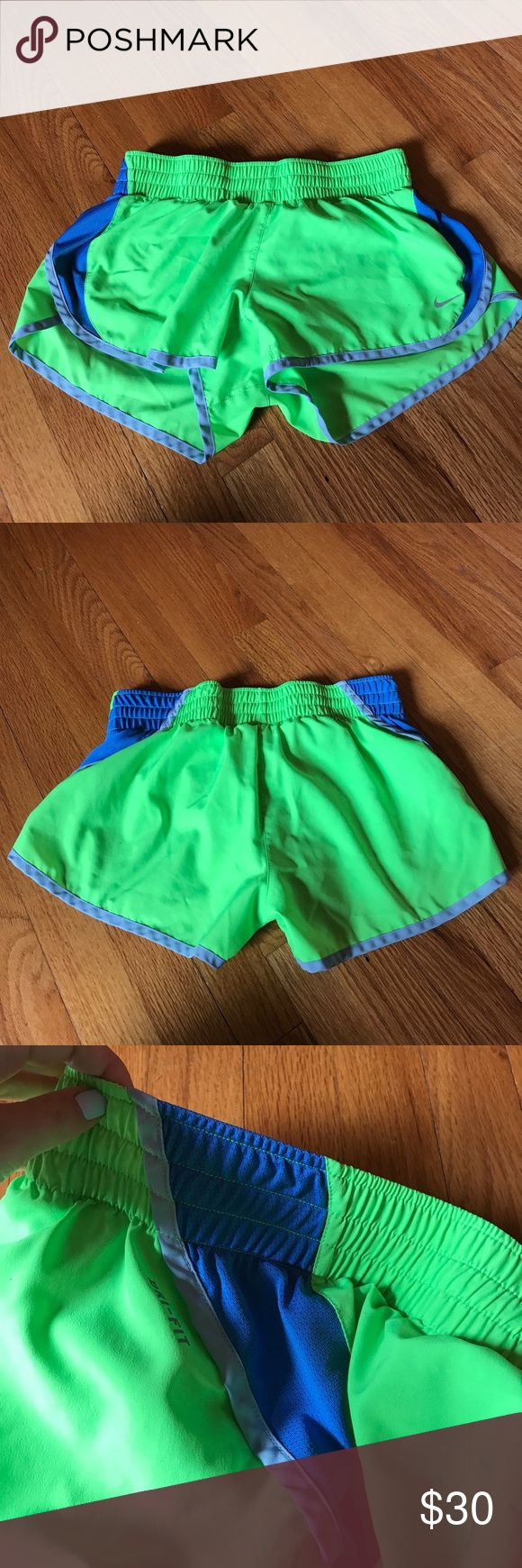 Nike dri-fit shorts Neon green shorts with blue mesh on both sides. Elastic waist. Built in lining on inside. Nike Shorts