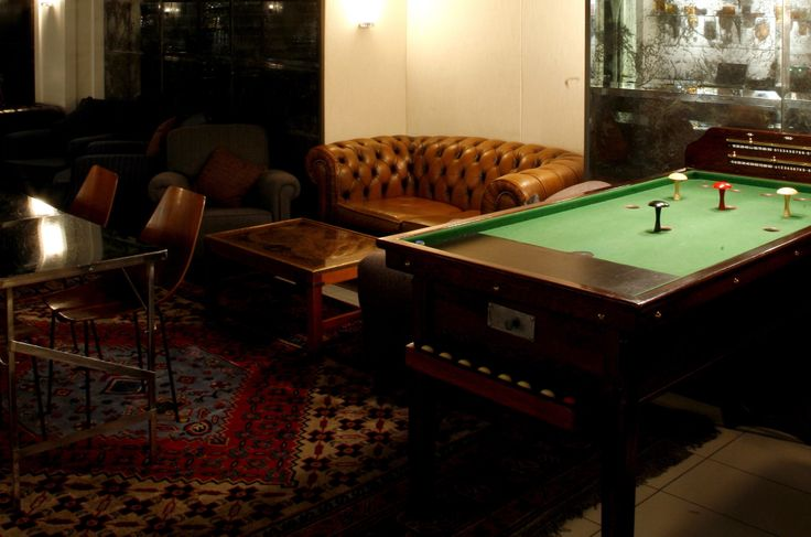 A subterranean speakeasy with plenty of style: low zinc bar, tin ceiling panels, comfortable Chesterfields and bar billiards table. Read more: http://www.timeout.com/london/bars-pubs/marks-bar