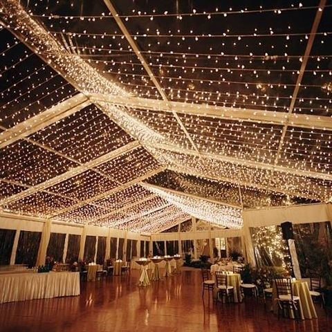 Cool idea to backlight the linens draped from the ceiling that I want at the reception.
