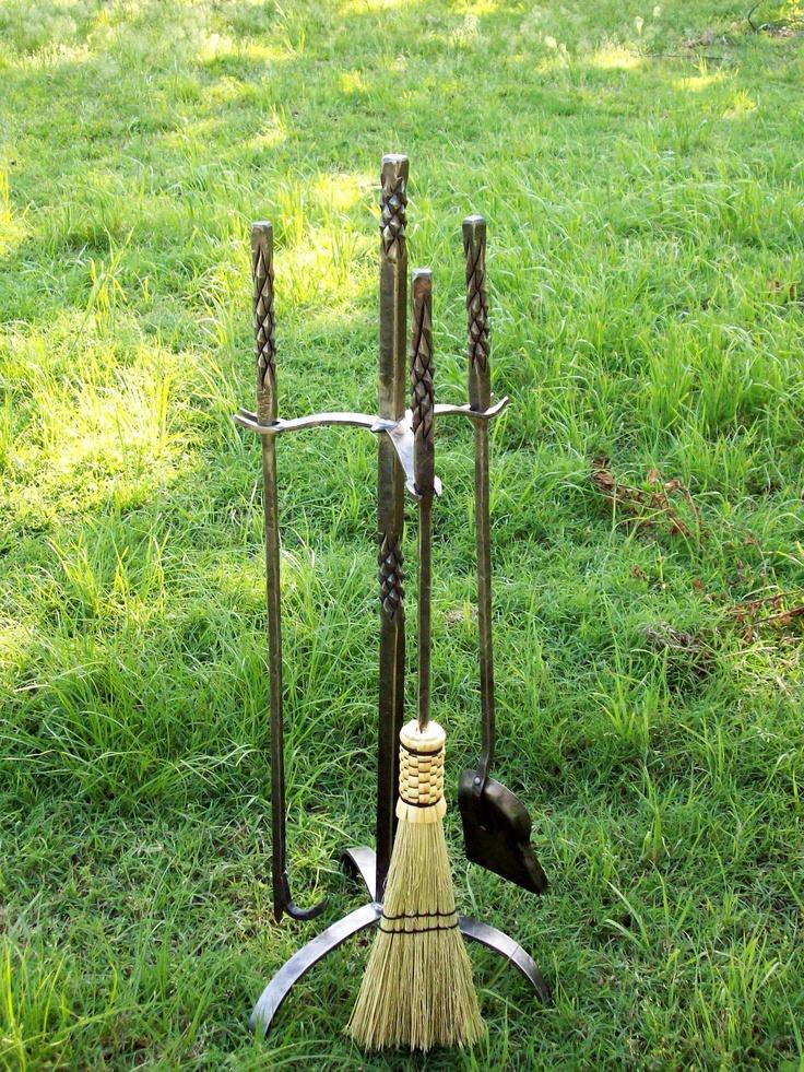 Bluebird Forge in Onalaska, Texas creates ironworks by hand, like this pineapple twist fireplace tool set.