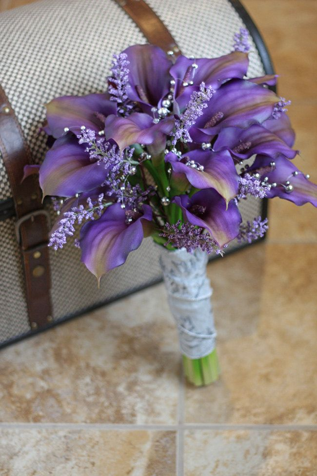 I love this...it seems so feminine. Real Touch Purple Calla Lily Wedding Bouquet - Purple Gray and Silver. $100.00, via Etsy.