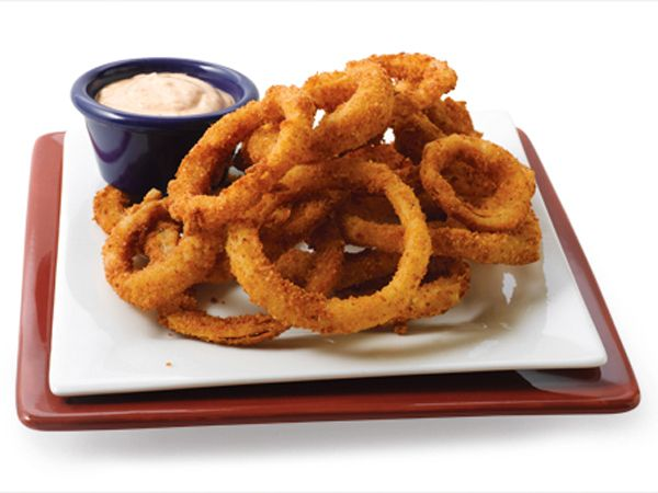 Since McDonald's doesn't sell onion rings, these crunchy, golden hoops from the world's number two restaurant chain are the most popular onion rings in the world. There are more than 12,000 Burger Kings in 61 countries these days, and after French fries, onion rings are the second-most popular companion to the chain's signature Whopper sandwich. Check out how simple it is to clone a whopping four dozen onion rings from one onion, using this triple-breading process. When frying...