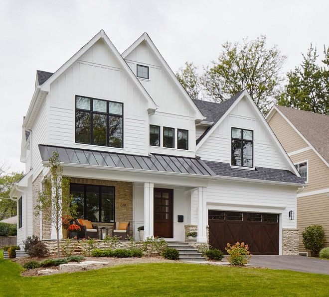 Exterior colors for lake house: black window trim, white siding, wood front & garage doors