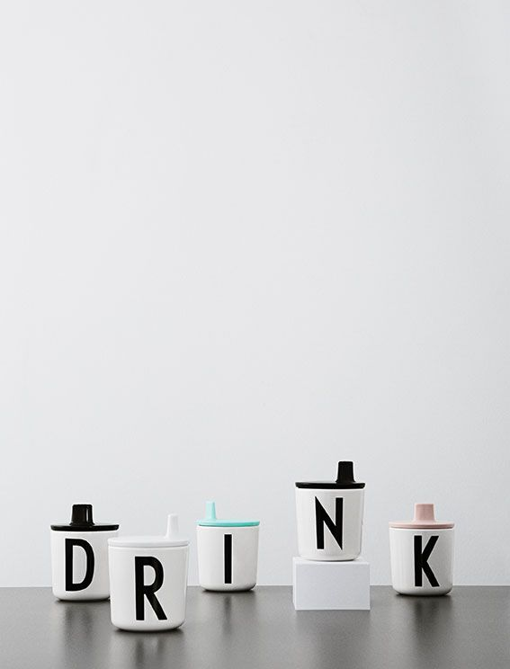 Personal melamine cups for kids. Add a drink lid for the smallest ones. Typography: Arne Jacobsen.